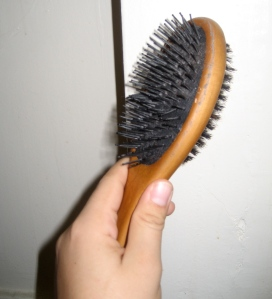 It's not too clear in this pic, but see that ring of grey shit ringing the wooden part of the brush? That's a quart of an inch straight-up hair grease. From ONLY ONE BRUSHING.
